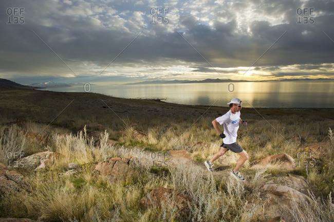 man trail running, Antelope Island, Salt Lake City, Utah