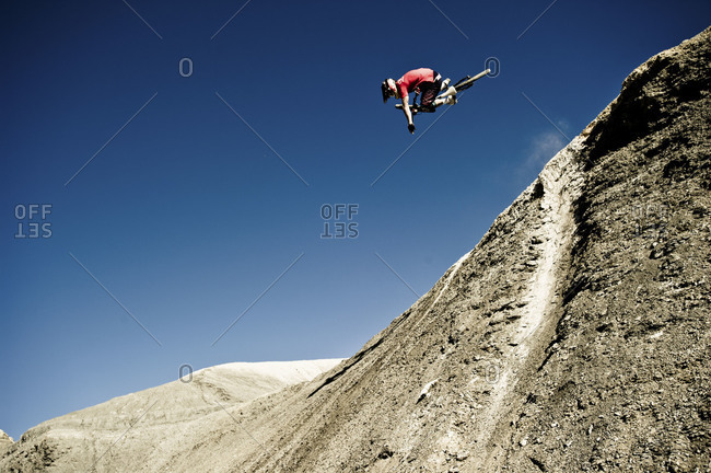 a man freestyle mountain bike jumping in Big Water, Page, Arizona