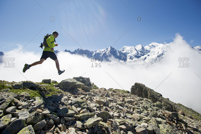 man running in the mountains of Montenvers in Chamonix, France