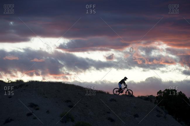 man goes mountain biking through the desert mountains of Southern Utah