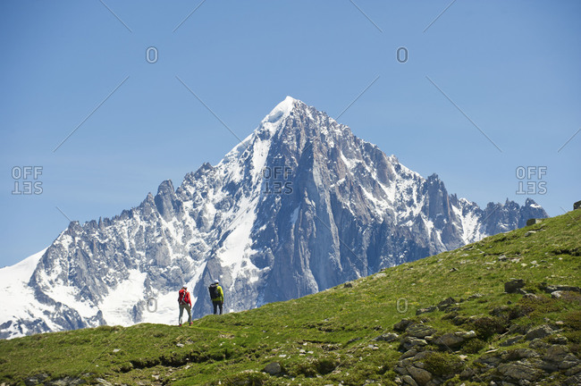 two people  hiking through the mountains of Le Brevent in Chamonix, France
