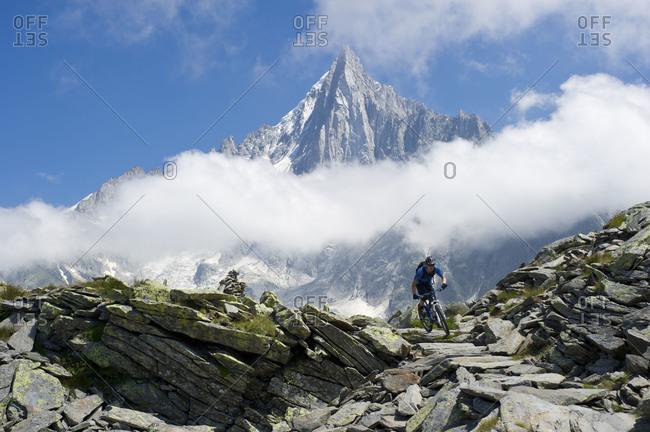 Man  mountain biking on La Montenvers in Chamonix, France while on the Tour Du Mt Blanc