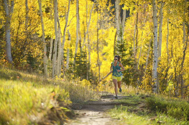 Park City, Utah: Woman running on a trail in