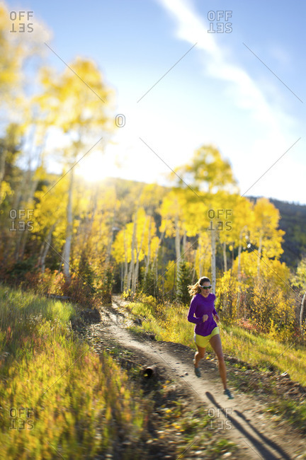 woman running on a trail in Park City, Utah