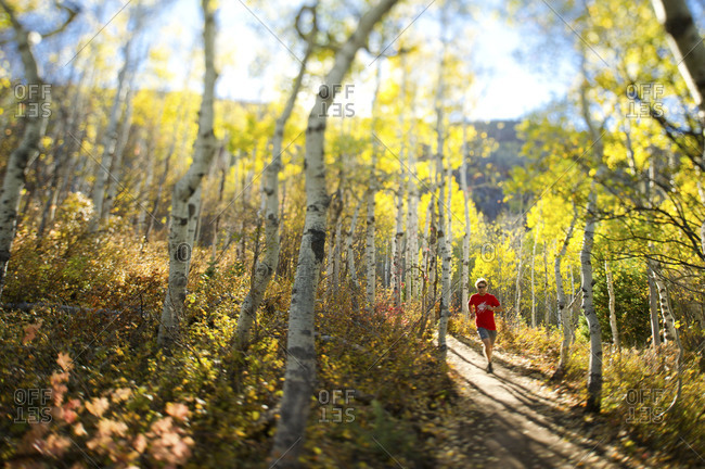 Man running on a trails in Park City, Utah
