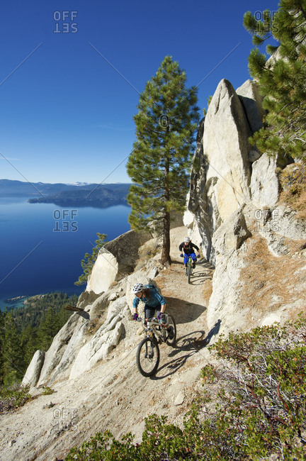 two people biking  on the flume trail in Lake Tahoe, Nevada