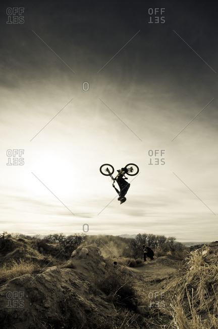 mountain biker mid-flip
