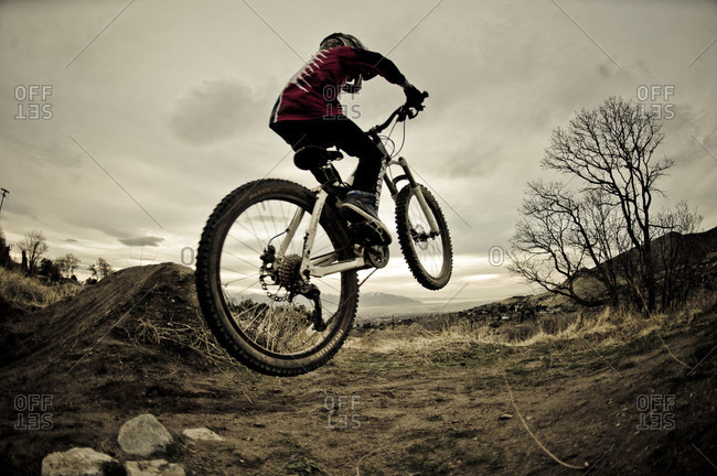 side view of a mountain biker mid jump