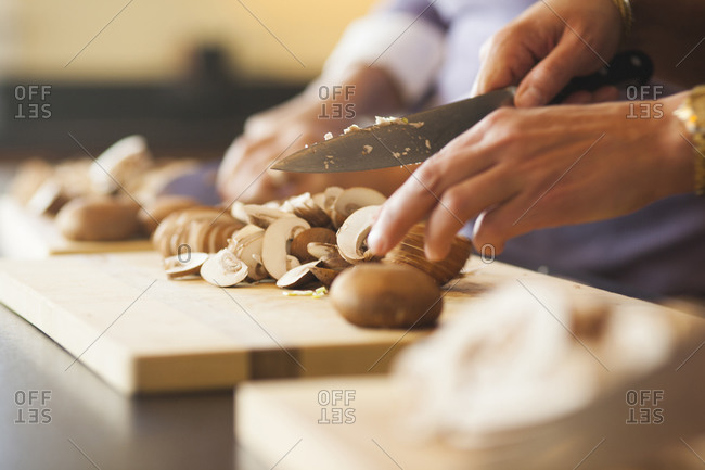 Close up of mushrooms being cut