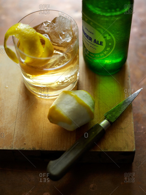 Horse's Neck cocktail made with brandy and ginger ale, with long spiral of lemon peel