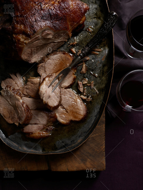 Asian spiced pork on a rustic oval-shaped pewter tray