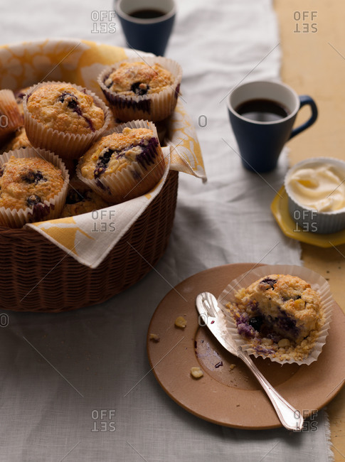 Blueberry-corn muffins on brown plate