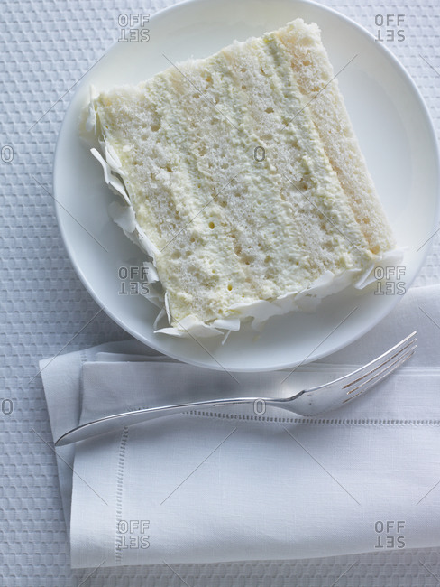 Top view of slice of coconut cake with vanilla butter-cream