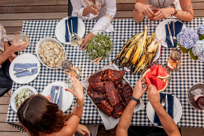Overhead shot showing young Caucasian friends having barbeque party outdoors