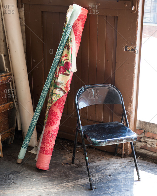 Interior composition with fabric bolts and old chair