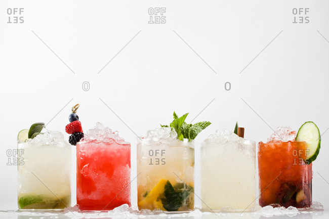 Collection of alcoholic cocktails served in old fashioned glasses