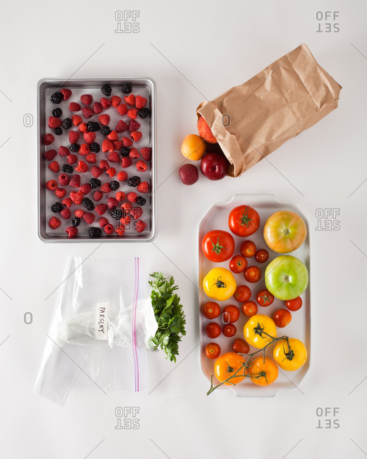 Organic fruits and vegetables displayed on white background