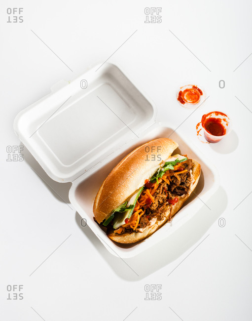 Beef sandwich with vegetables served in foam box for taking away