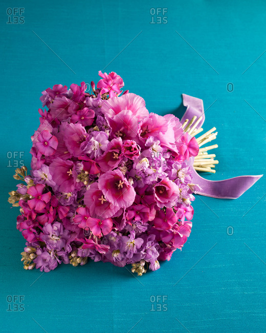 Pink bouquet on blue background
