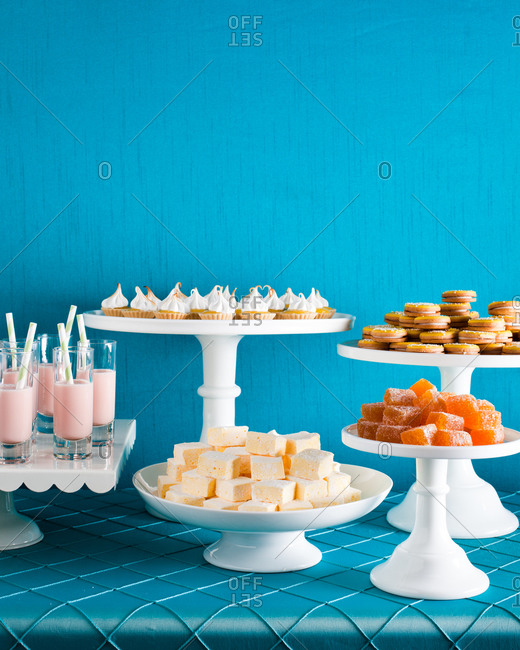 Dessert table with cupcakes and various sweets