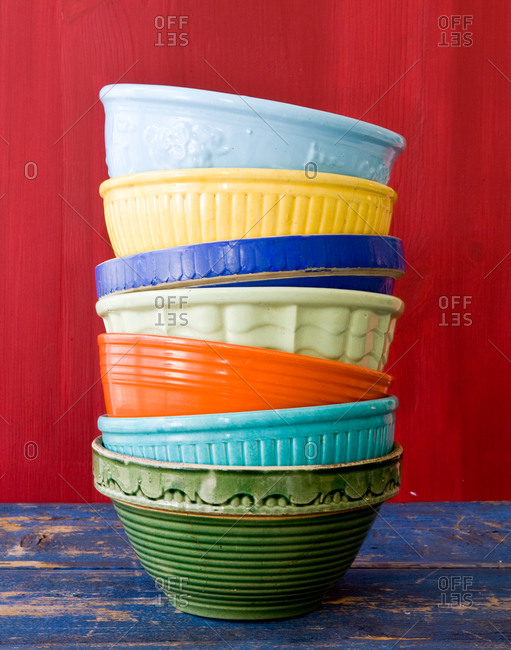 Stacked colorful bowls on table
