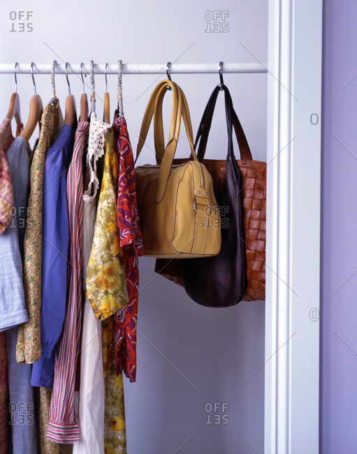 Clothes and bags hanging in closet