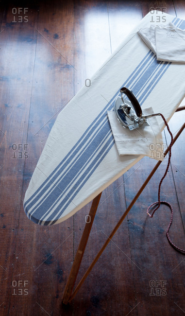 Iron and clothes on ironing board