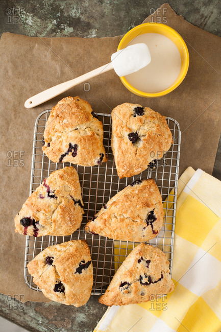 Freshly baked blueberry scones with icing on the side
