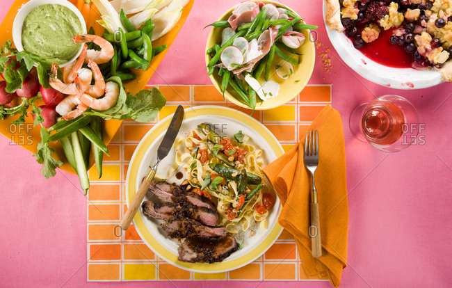 Summer menu with grilled lamb and various dishes