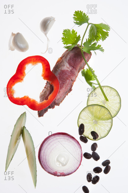 Still-life of different ingredients on white surface