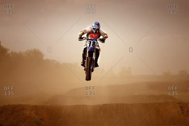 Motocross Rider riding up a hill
