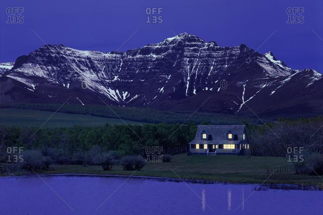 Cabin Beside Lake And Mountain