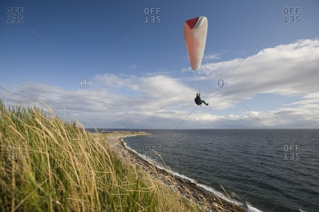 Paragliding On The West Coast; Clover Point, Victoria, Vancouver Island, British Columbia, Canada