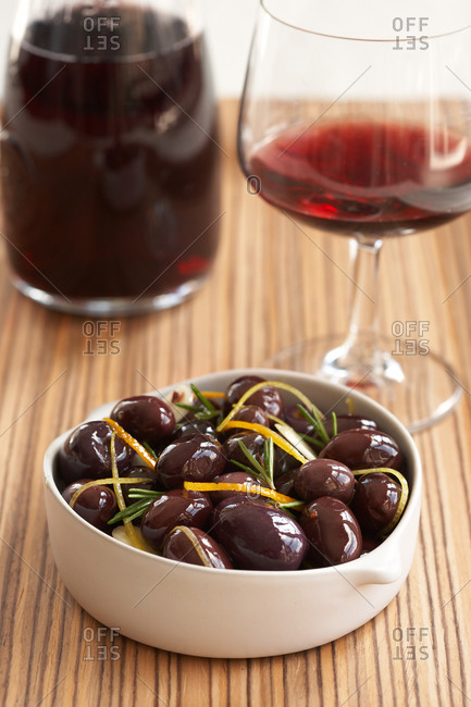 Traditional Spanish tapas: big black olives served with red wine