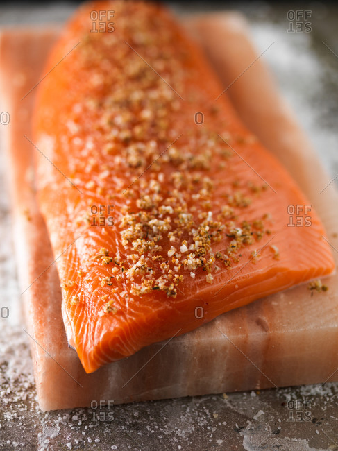 Piece of salted salmon on Himalayan salt tile.
