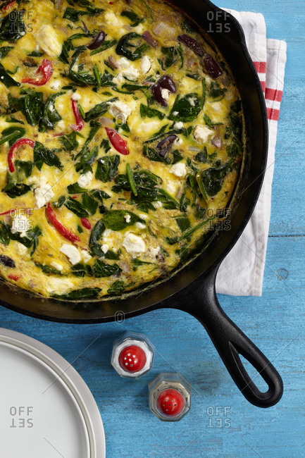Top view of spinach frittata prepared in skillet