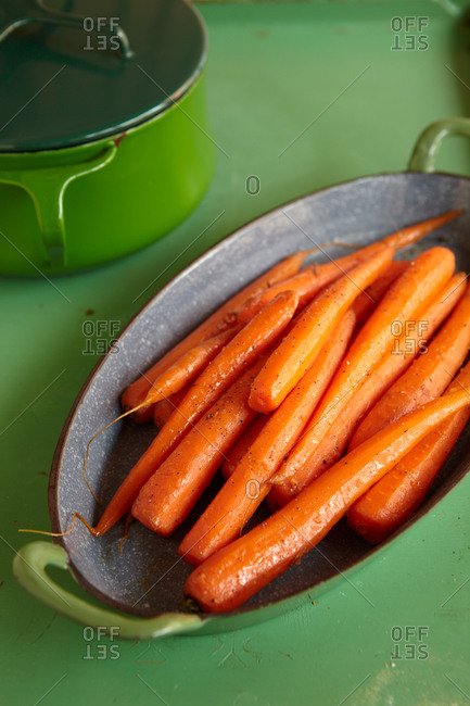 Pile of cooked carrots in oval-shaped dish