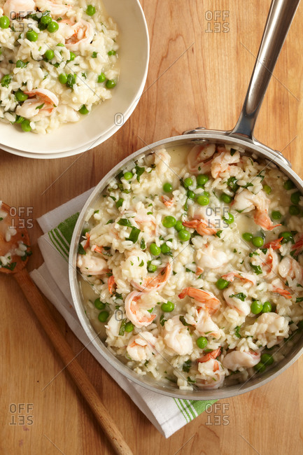 Shrimp and pea risotto in stainless steel pot