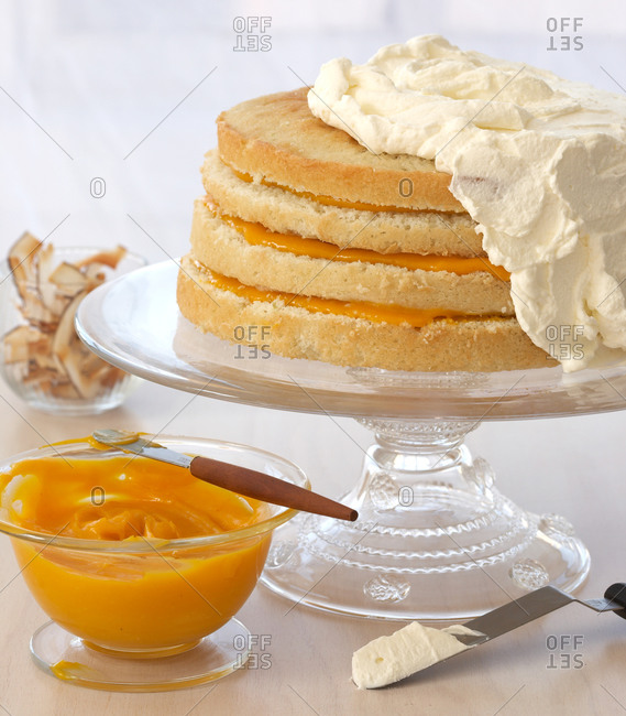Cake layered with mango puree and coconut buttercream