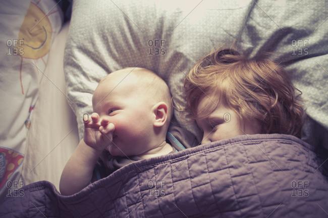 two children under a blanket