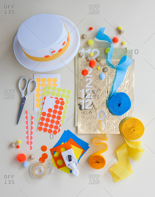 Hat making supplies on a white table