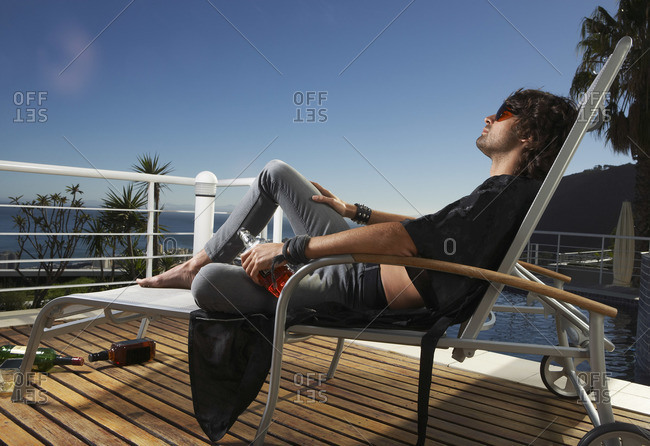 Man sitting on patio chair