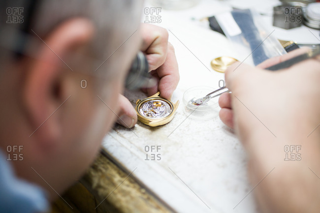 Close-up of watchmaker at work