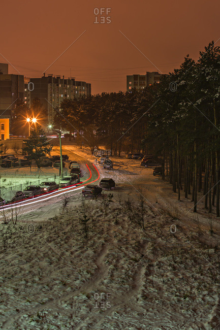 Long exposure shot of cars moving on a snowy street at night, Voronezh, Russia