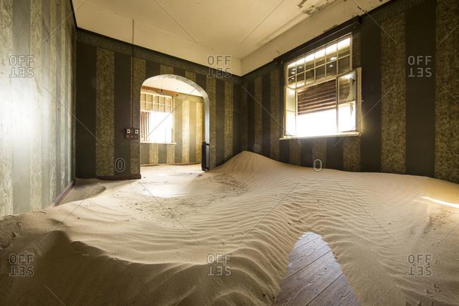Sand filled living room in Kolmanskop