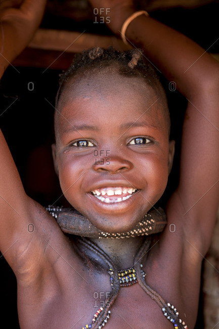 Smiling Himba girl in Namibia