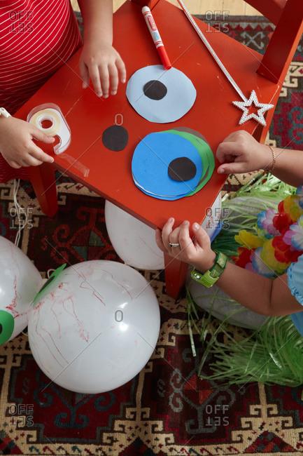 Children making eyeballs out of balloons