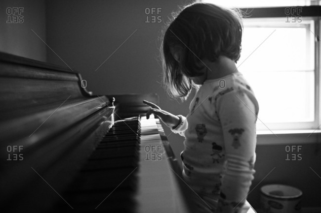 A child plays a piano alone