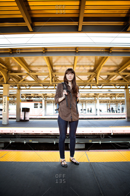 Young woman waiting for a train at the station