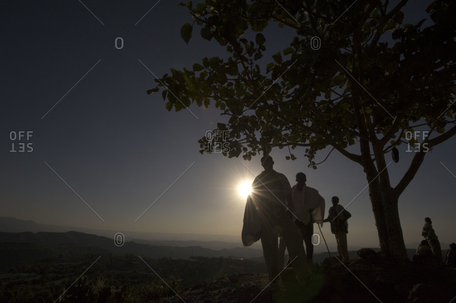 Ethiopian people standing in sunset in Lalibela, Ethiopia